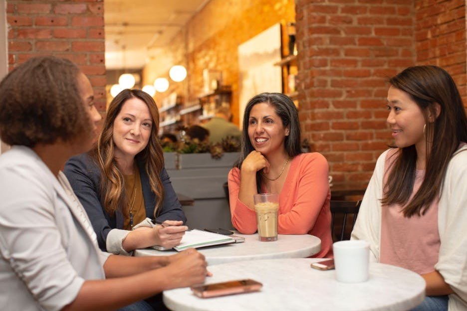 Business women sitting around a table