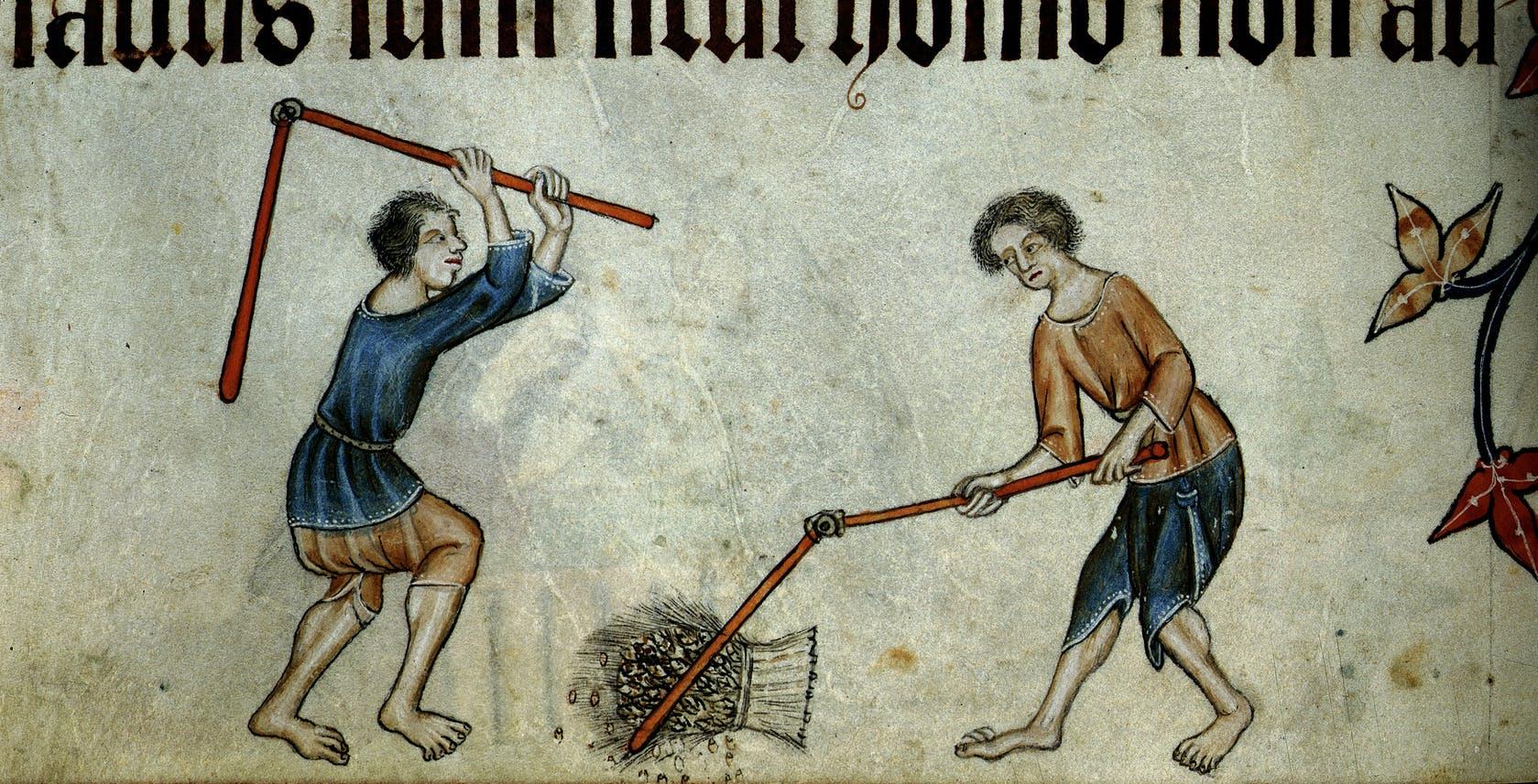 Tough day job: threshing wheat.