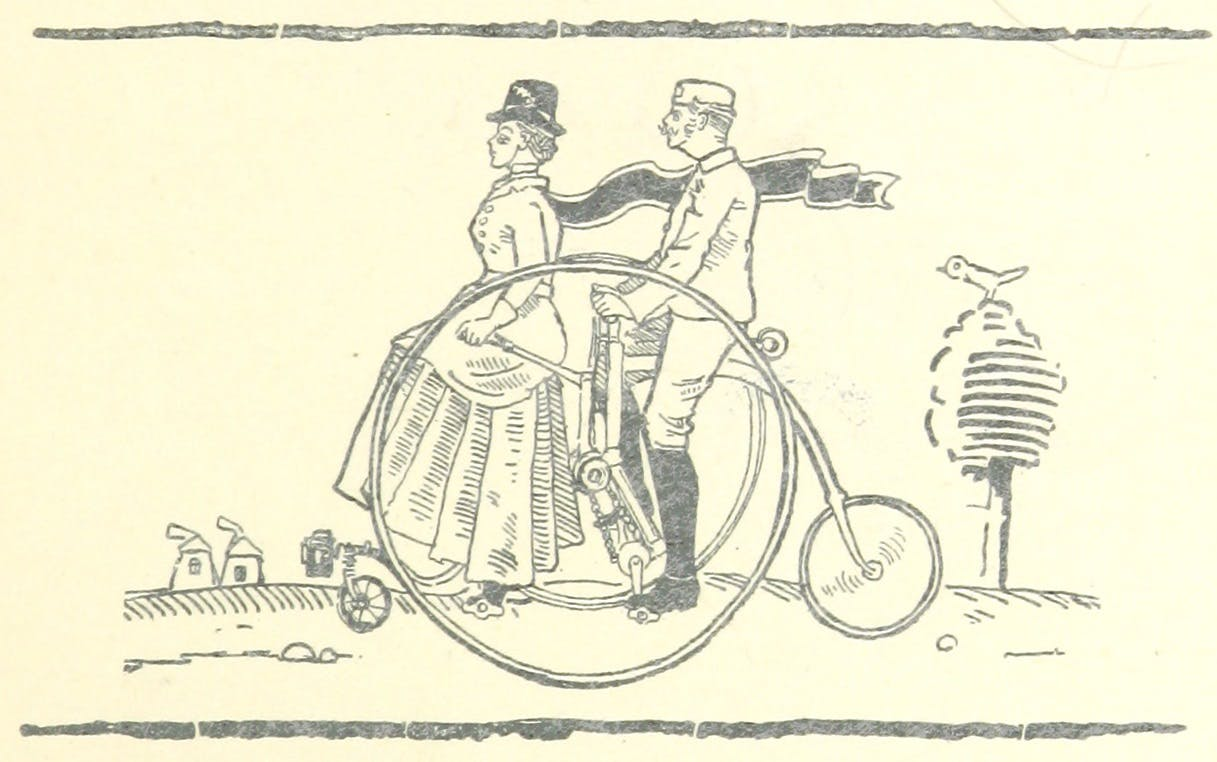 A man and woman on a bicycle.