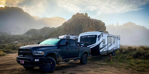 Outback travel trailer being pulled in the mountains