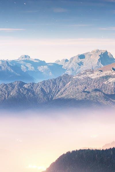 Keystone RV 3-year warranty mountains and fog background