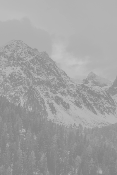 Background image of snow covered mountains.