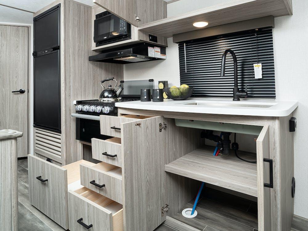 Passport 219BH kitchen drawers open