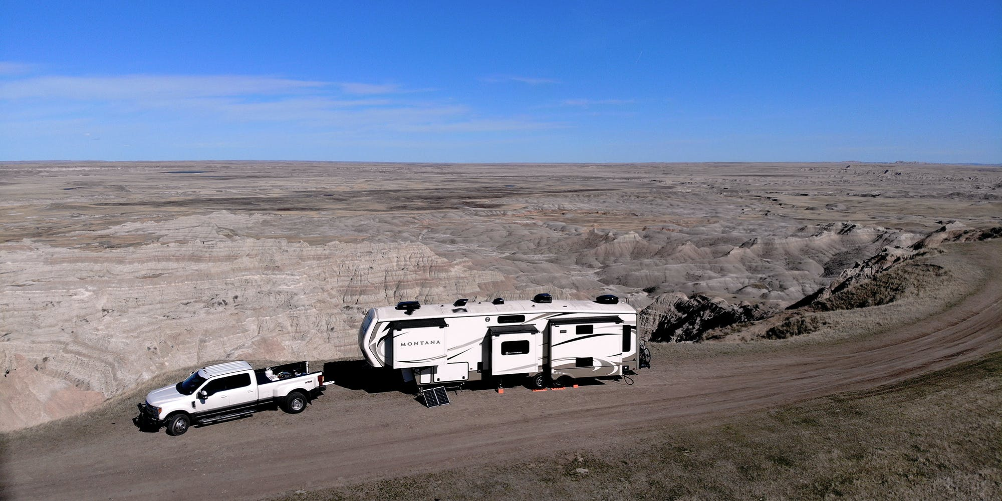 A fifth wheel parked in the Badlands National Park.