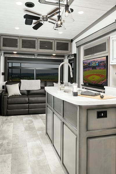 Interior shot of an RV kitchen and living area.