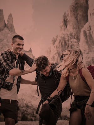 A group of friends laughing during a canyon hike.