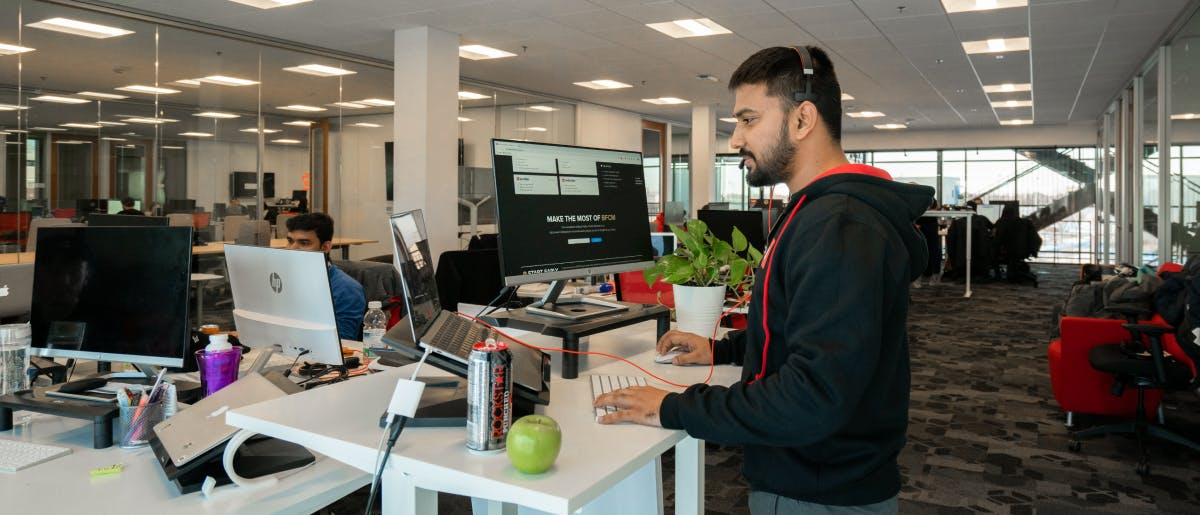 Employee working at standing desk