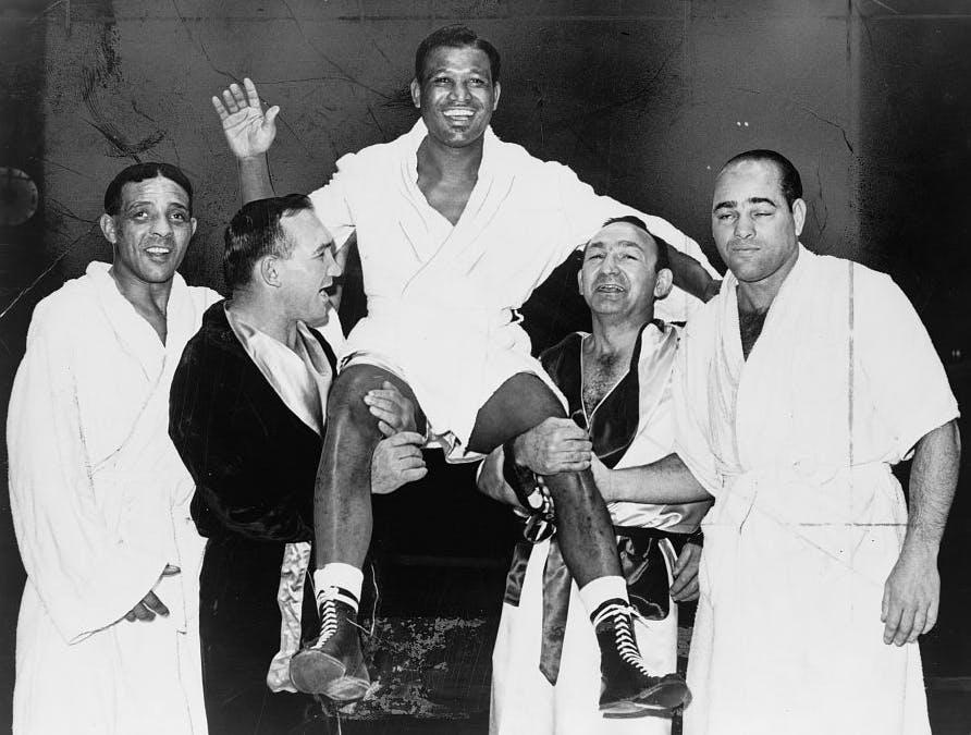 Sugar Ray Robinson held aloft by boxers, 1965, Public Domain