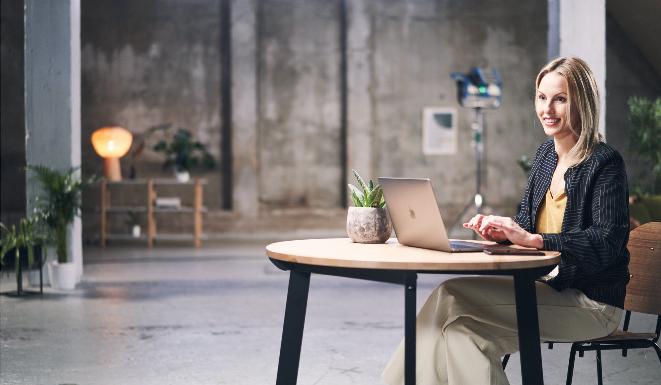 Woman sitting at a desk with a laptop computer