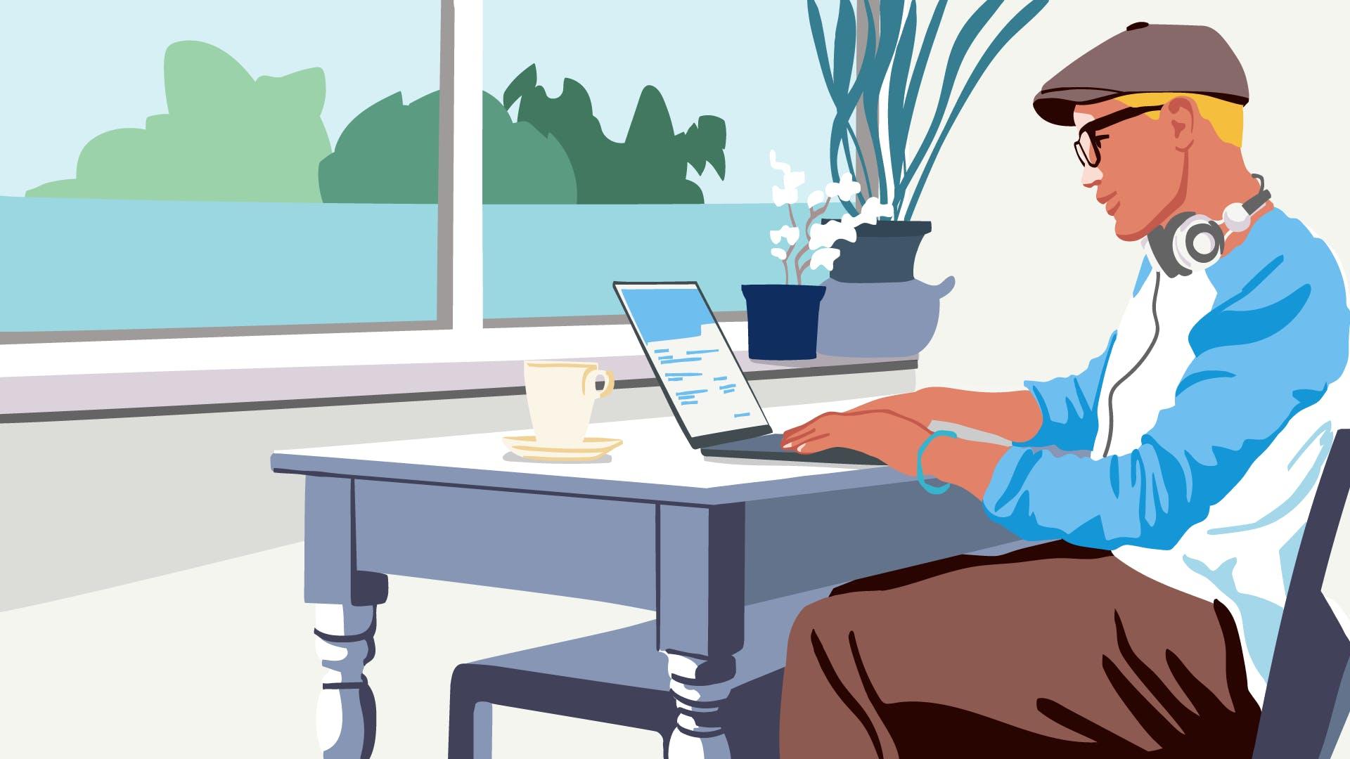 Mann mit Mütze tätigt am Laptop eine Online Überweisung.
