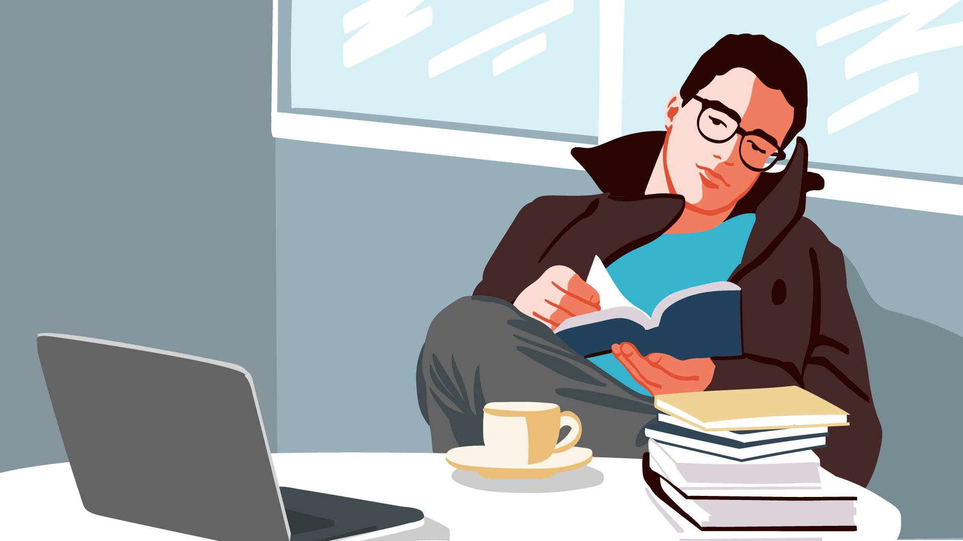 Mann sitzt mit einem Kaffee vor einem Schreibtisch und liest.