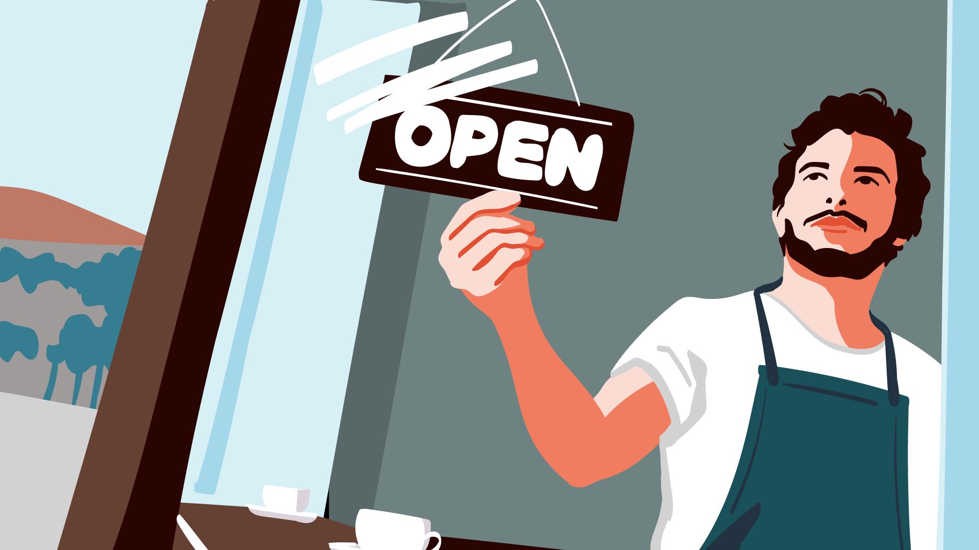 Händler eines Kleingewerbes an der Tür seines Ladenlokals.