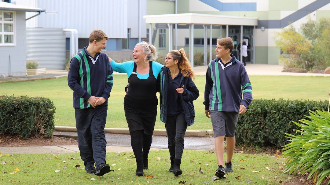 Liz walking with students