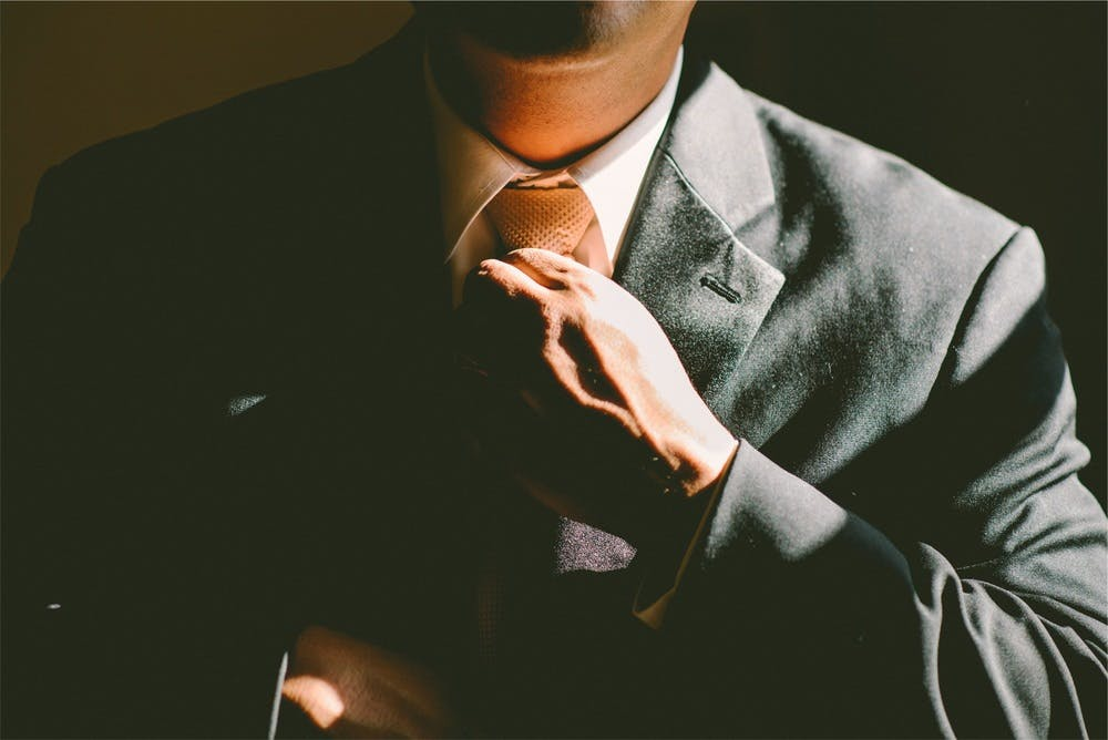 Image of person with suit on