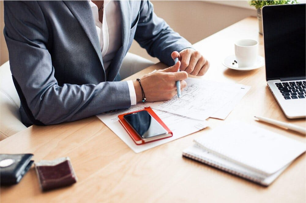 Image of person doing bookkeeping at a desk