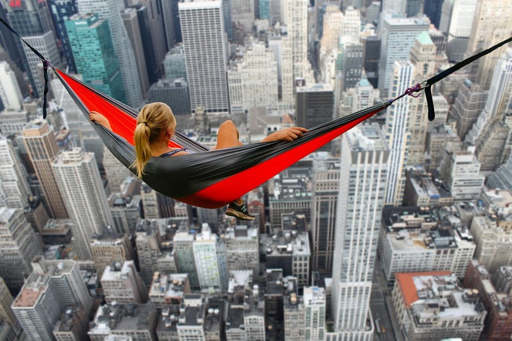 Person in a hammock looking at the city