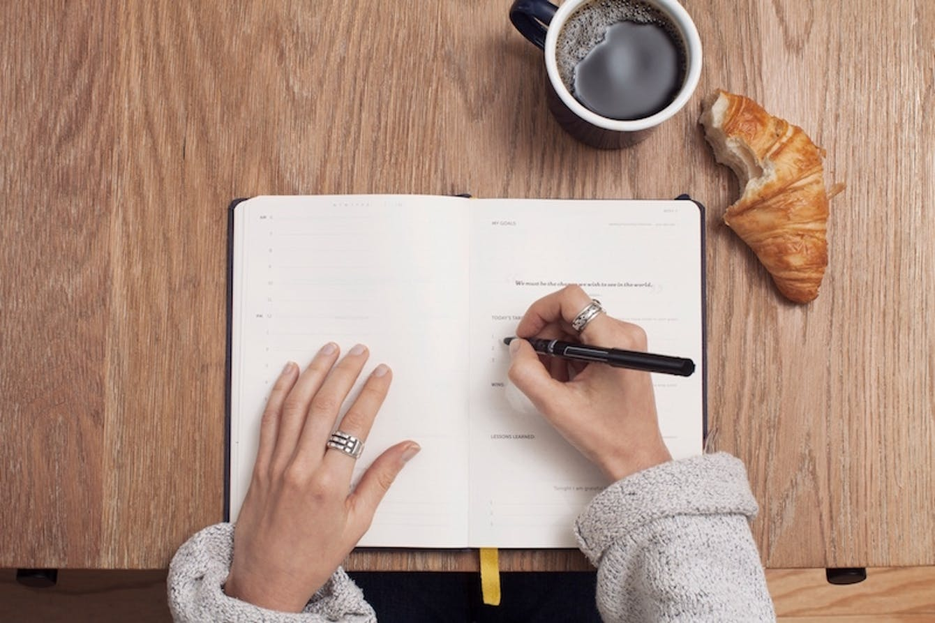 Image of person taking notes
