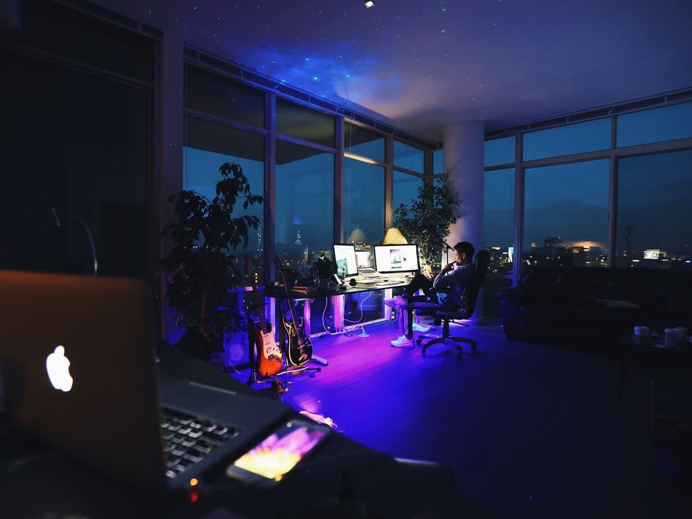 Person working at a computer at night