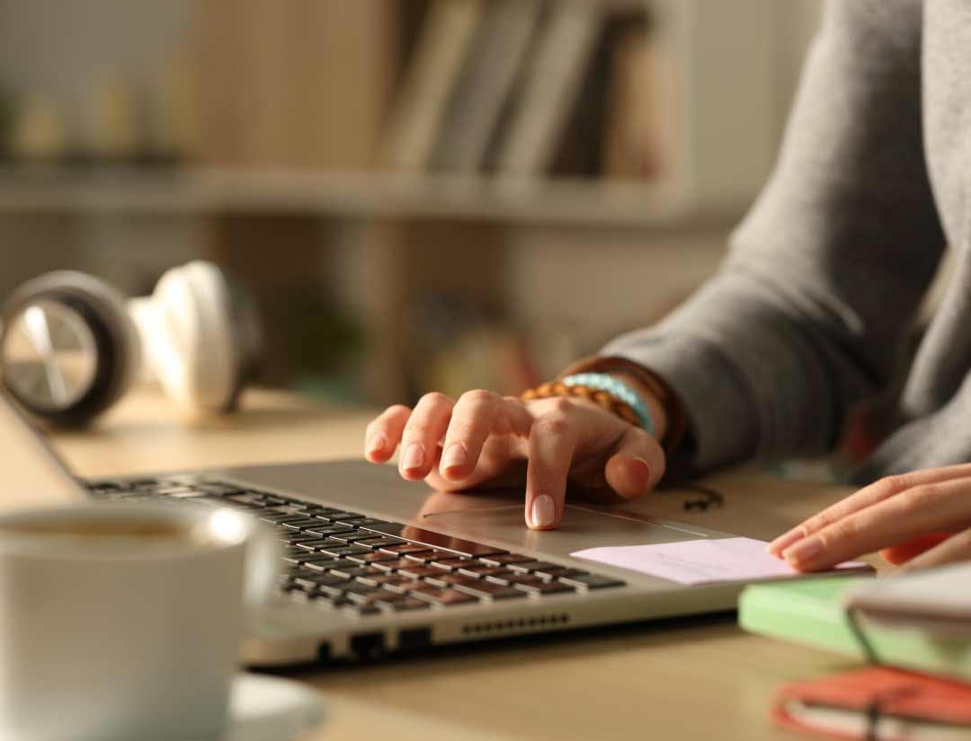 Hands using a laptop