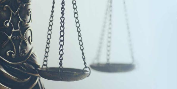 Decorative: Image of scales of justice