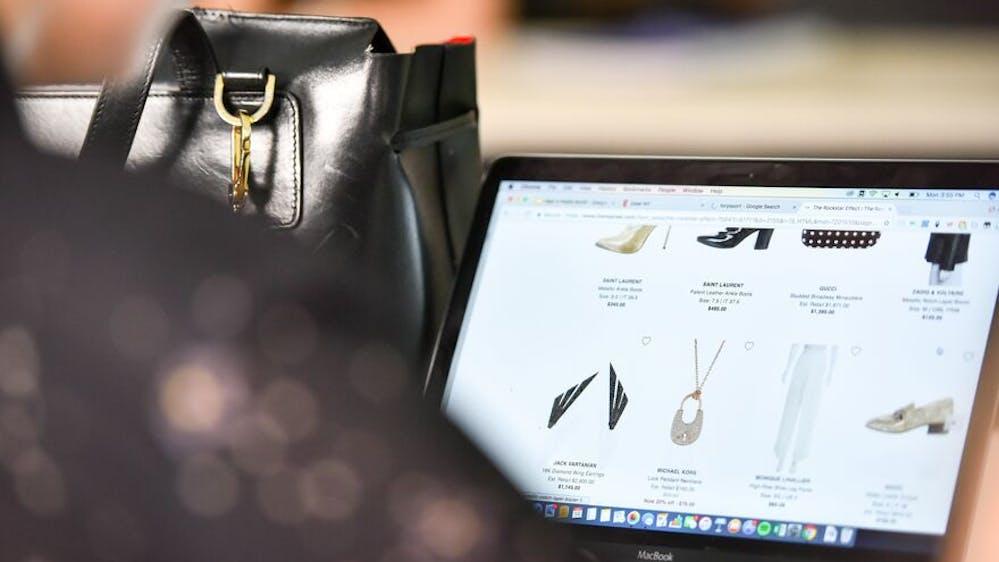 Decorative: laptop showing website of luxury fashion brand
