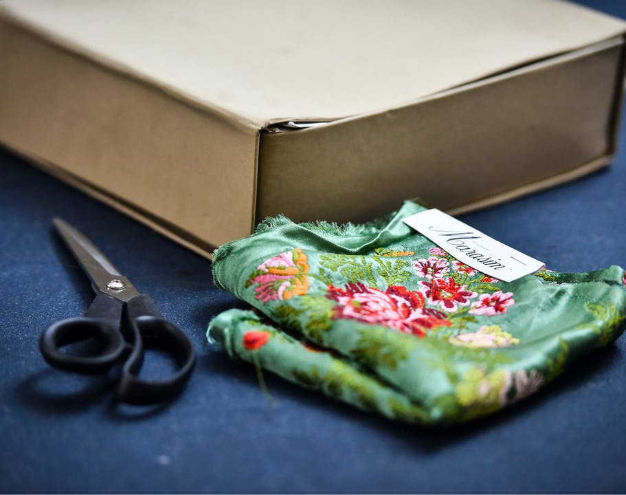 Scissors, fabric, and shipping box