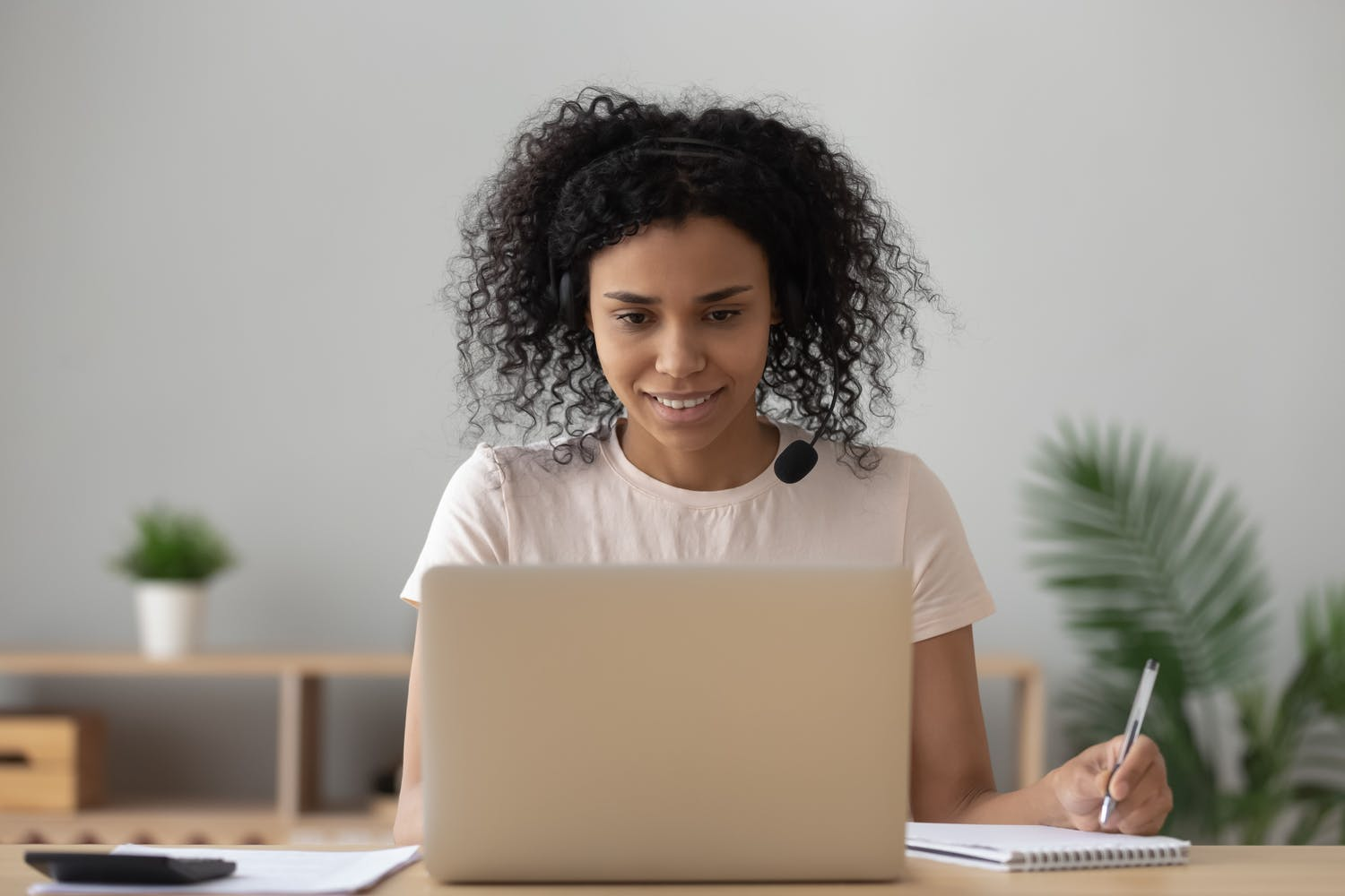 Decorative: Student studying at her own pace on computer