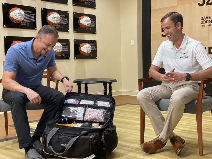 Dr. Waterman and guest viewing the contents of a sports medicine bag