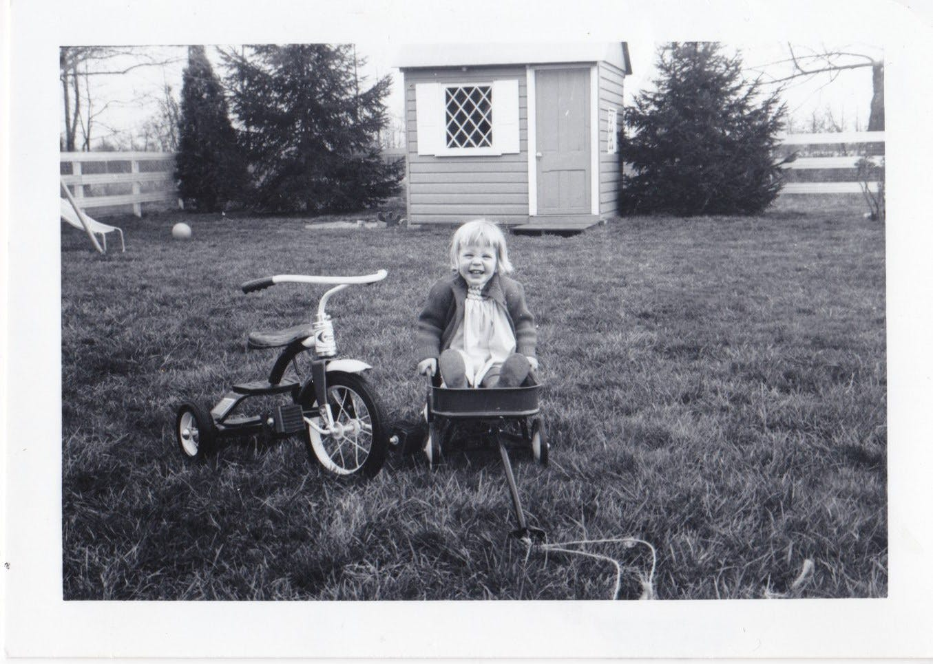 little Kristin in a wagon