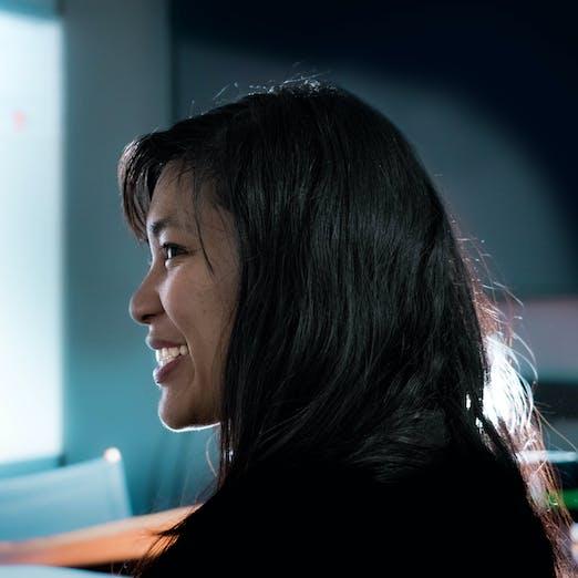 Angela Natividad in profile, looking left