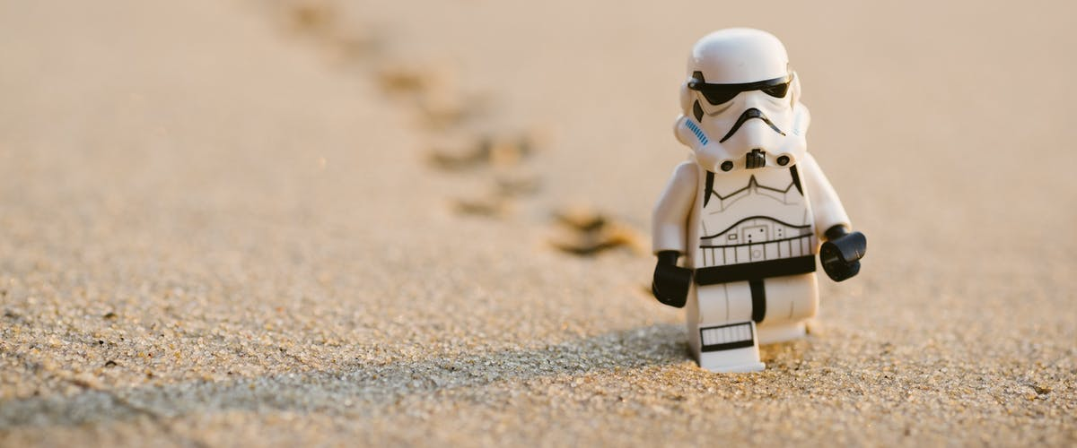 Lego StormTrooper walking in the sand