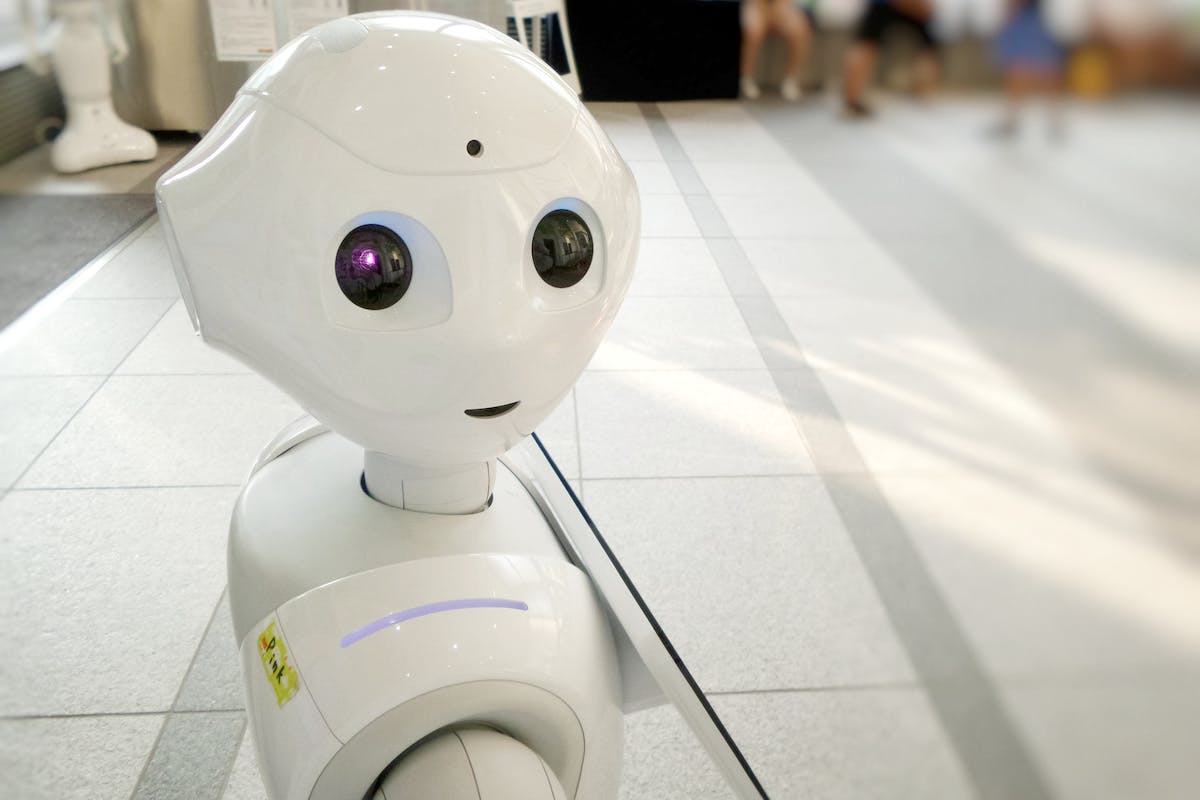 cute white robot with a blurred background