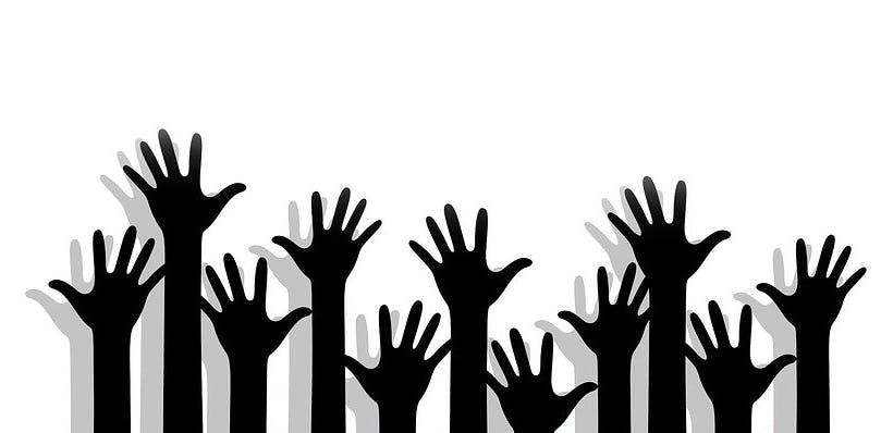 Hands volunteering