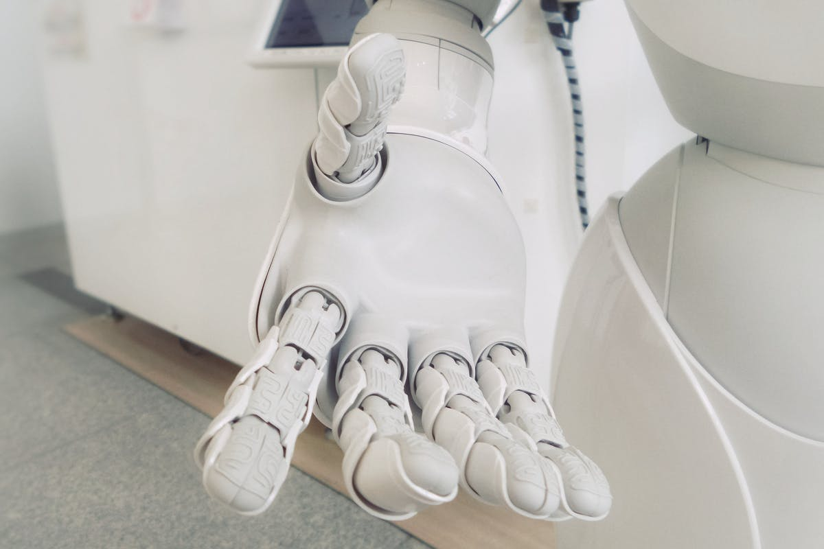 white robot hand reaching out