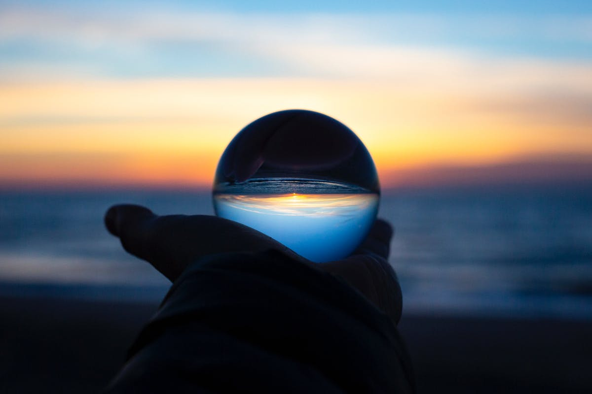 Glass Orb reflecting the ocean