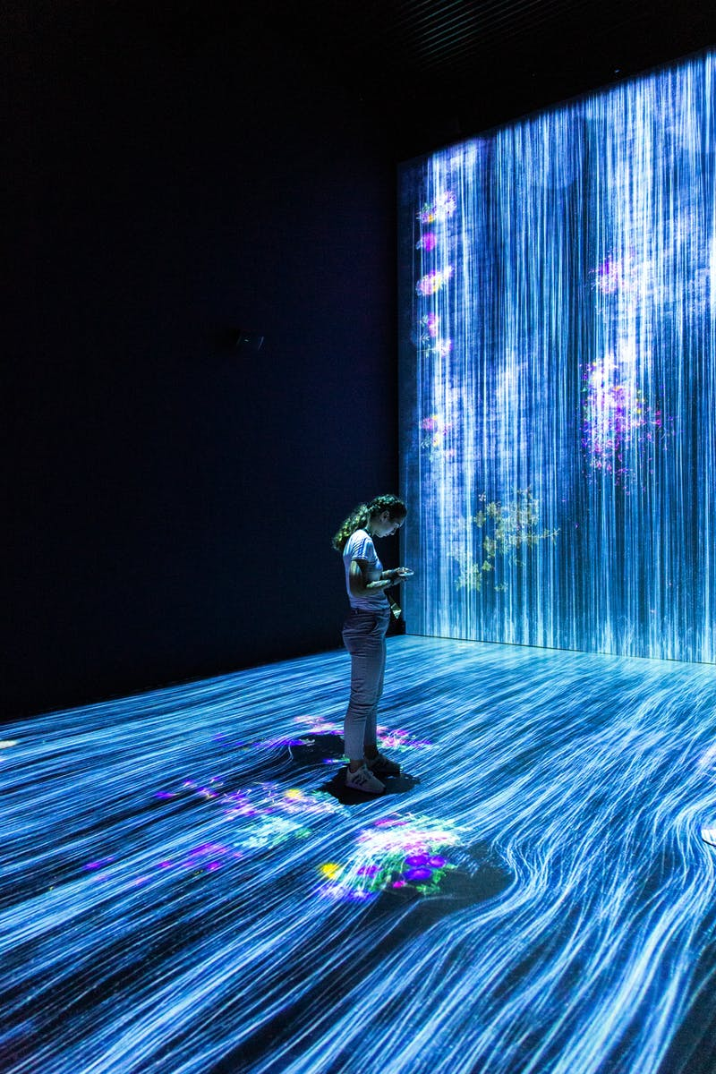 Woman stood on a modern art installation of fibre optic cables