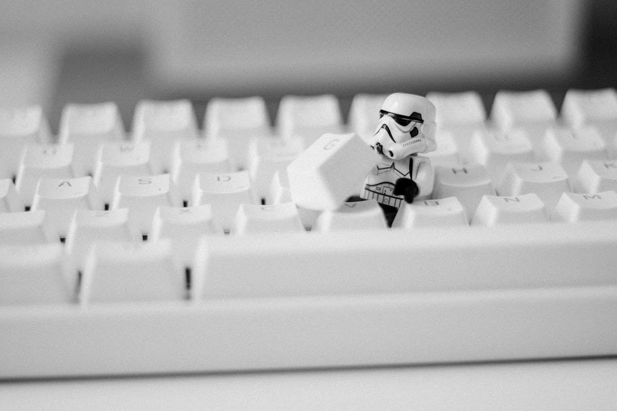 Lego Stormtrooper hiding in a keyboard