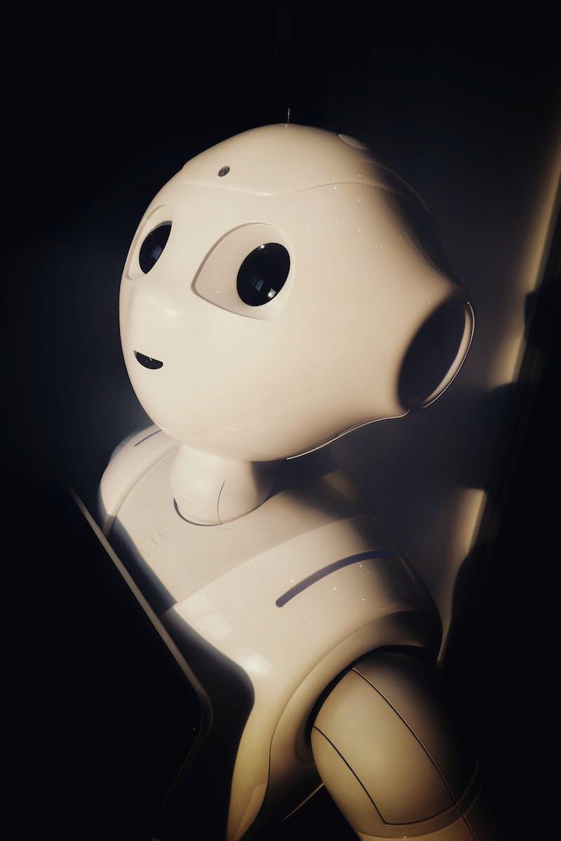 White robot in a dark background