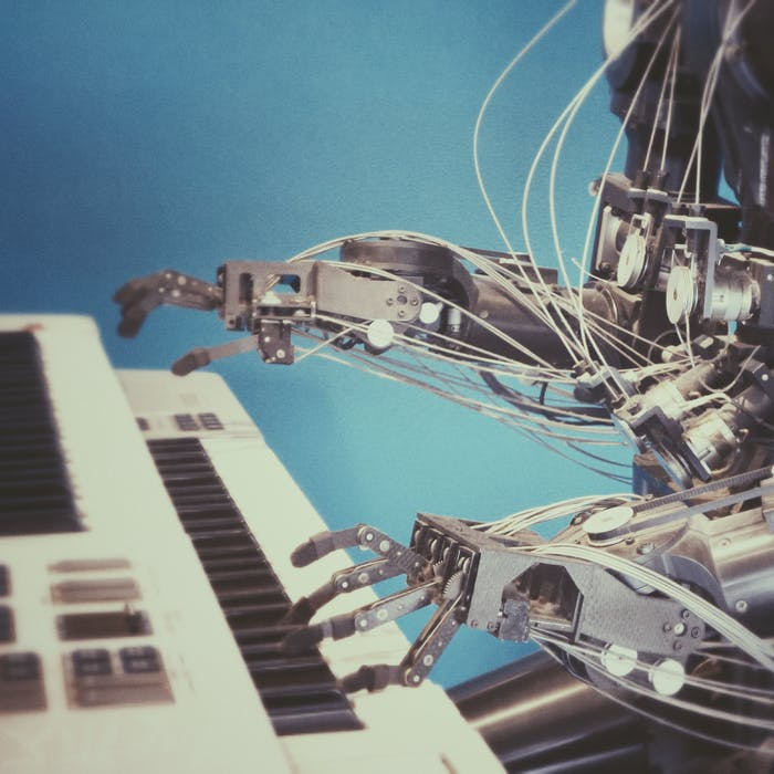 Robot with exposed circuitry playing piano