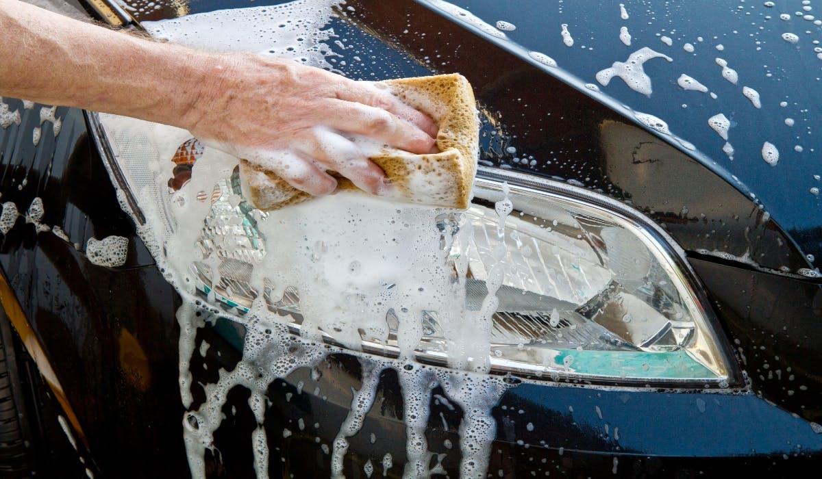 washing car headlights