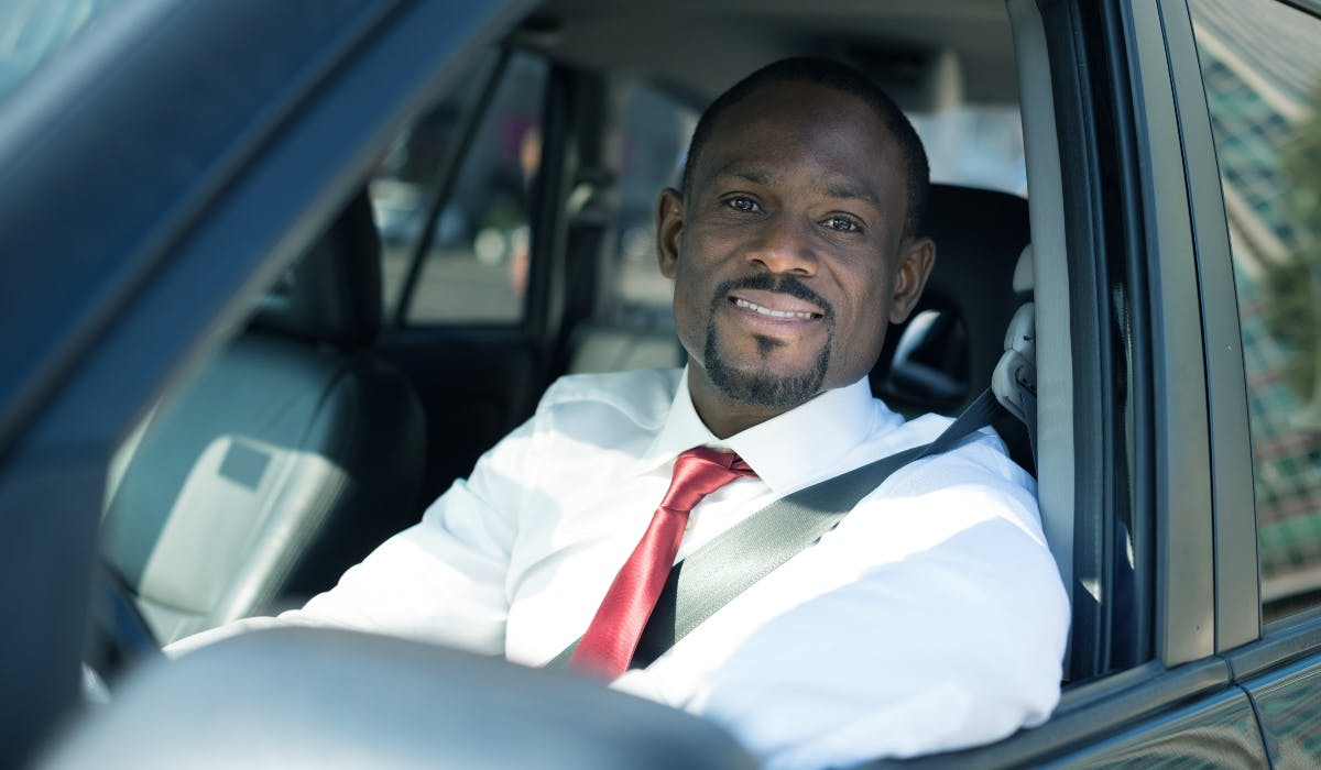 business man in business lease car