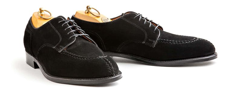 A pair of black suede Alden x Leffot NST bluchers.