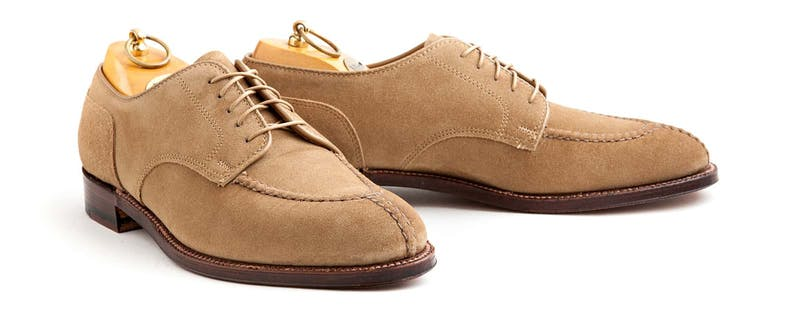 A pair of tan suede NST bluchers.