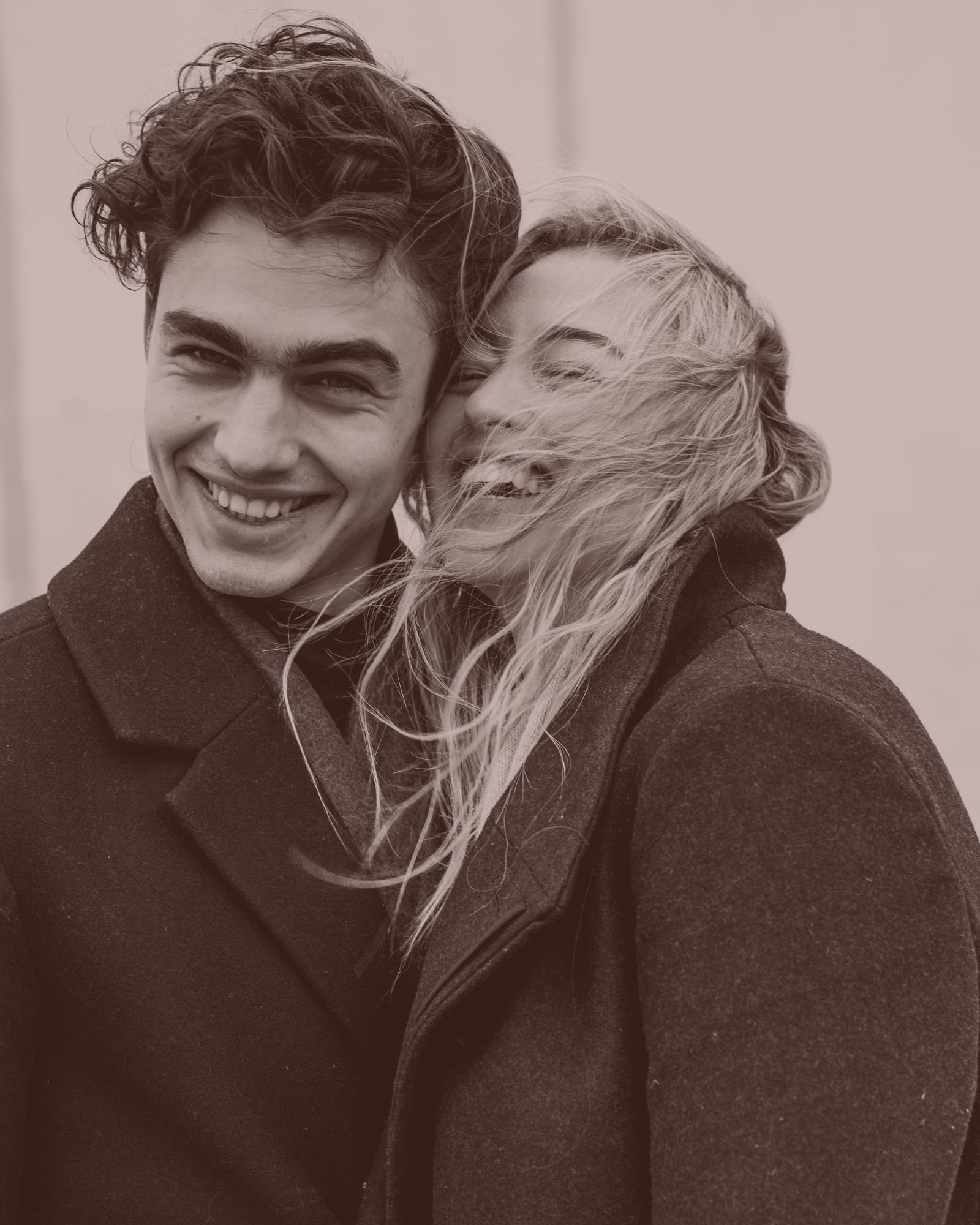Instagram model Iskra laughing with a man.