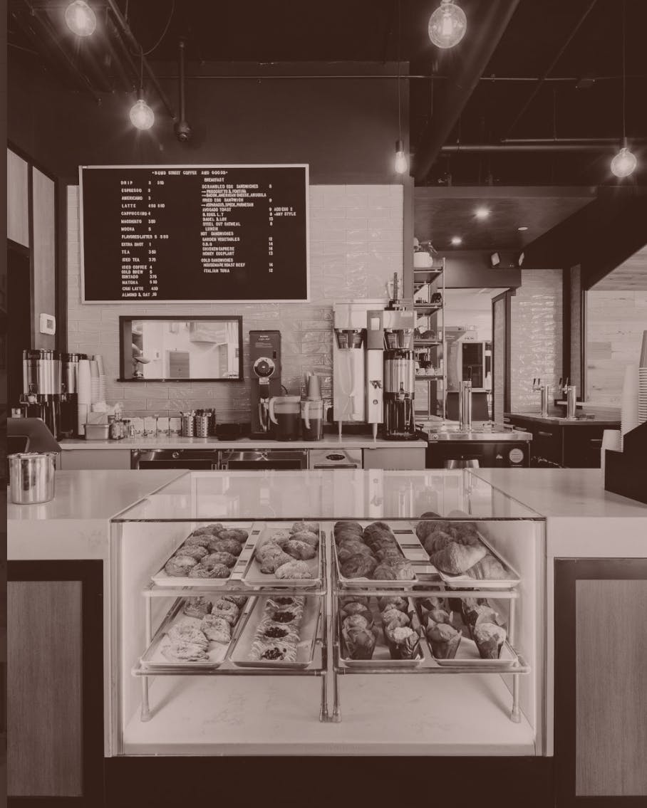 Pastries and coffee at the counter.