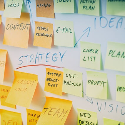 Close-up of Post-It notes on a whiteboard
