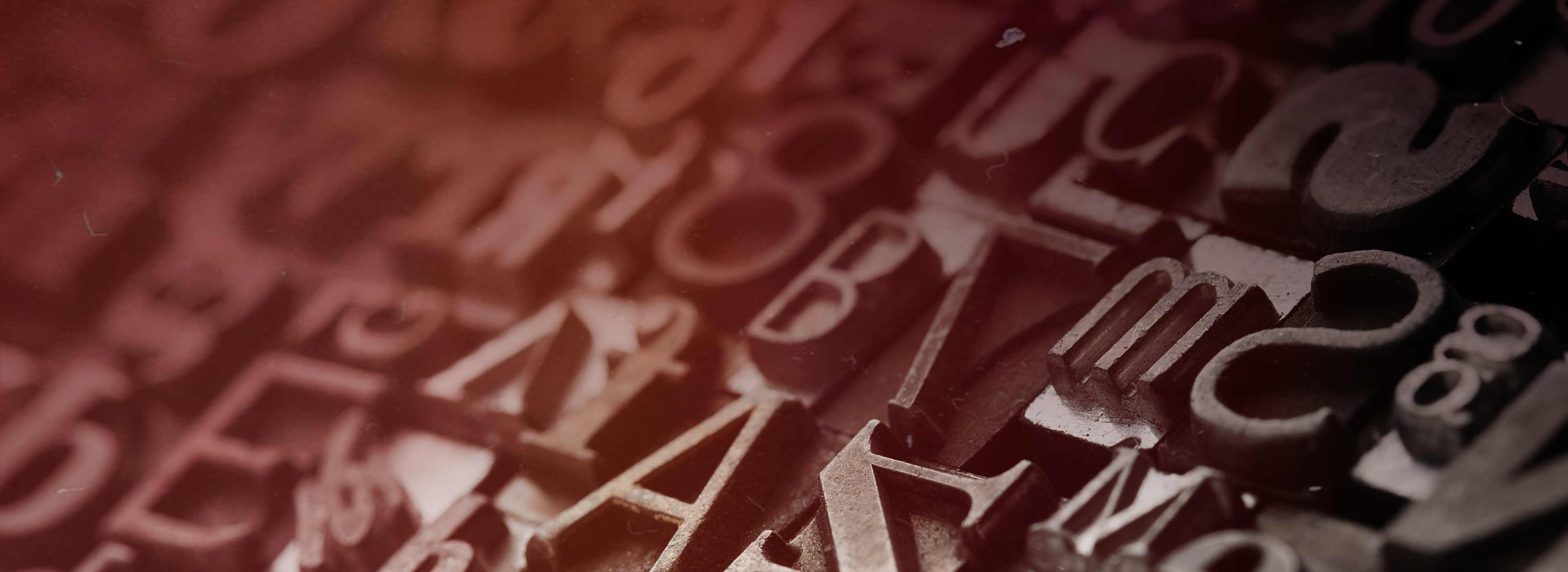 Close-up of antique printing press letters