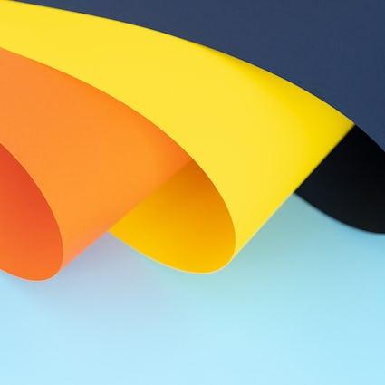 Orange, yellow and dark blue curves on light blue background