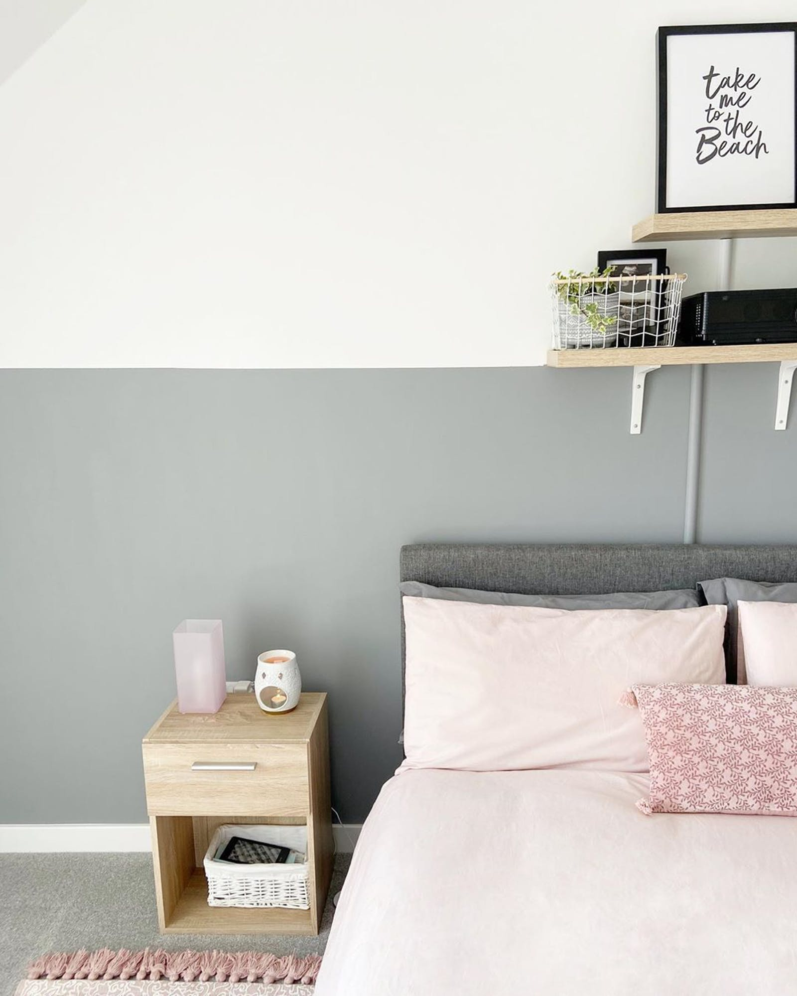 Bedroom painted in Lick Grey 06 with pink bedding and soft furnishings