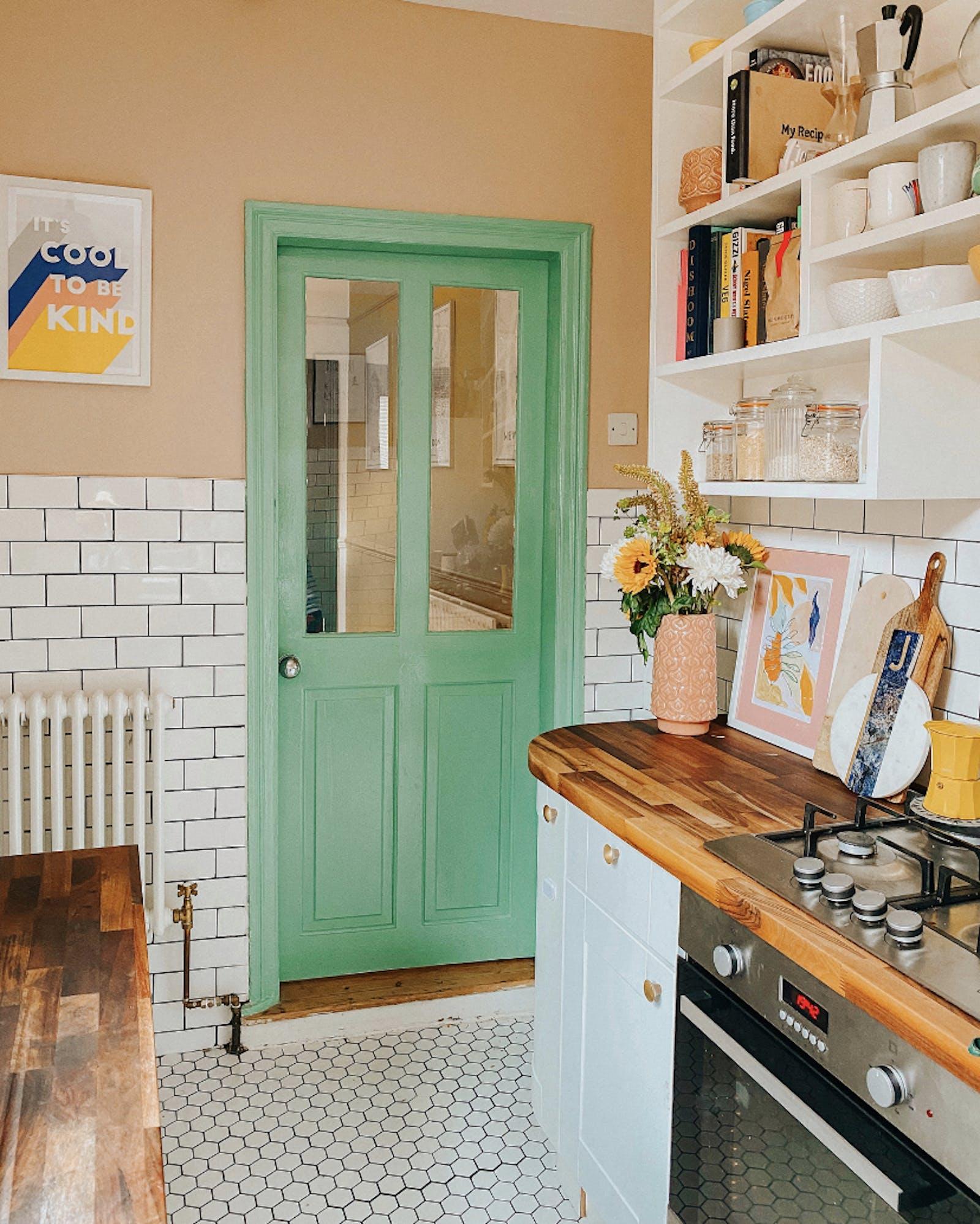 Vibrant green accent kitchen door